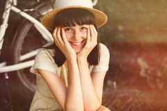 Young woman with retro bicycle in a park Stock Images