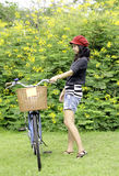 Young woman with retro bicycle in a park Royalty Free Stock Images