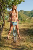 Young woman with retro bicycle Royalty Free Stock Image
