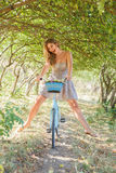 Young woman with retro bicycle Stock Image