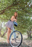 Young woman with retro bicycle Royalty Free Stock Photos