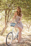 Young woman with retro bicycle Stock Photos