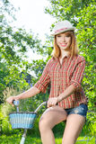 Young woman with retro bicycle Stock Photography