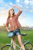 Young woman with retro bicycle in a park Royalty Free Stock Image