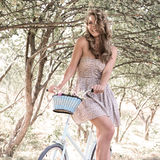 Young woman with retro bicycle in a park Stock Photo