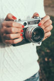 Young woman with a retro camera Royalty Free Stock Image