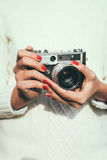 Young woman with a retro camera Stock Photo