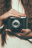 Young woman with a retro camera Stock Photography
