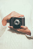 Young woman with a retro camera Royalty Free Stock Images