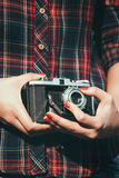 Young woman with a retro camera Royalty Free Stock Photo