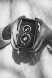 Young woman with a retro camera Royalty Free Stock Photography