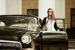 Young woman with a retro car Stock Photos