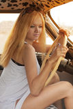 Young woman in a retro car Royalty Free Stock Image