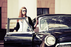Young woman at the retro car Stock Photo