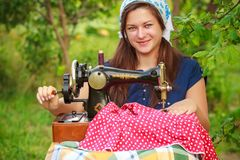 Young woman with retro hand sewing machine Royalty Free Stock Photography