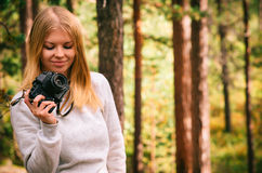 Young Woman with retro photo camera outdoor Royalty Free Stock Photography