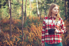 Young Woman with retro photo camera outdoor Stock Images