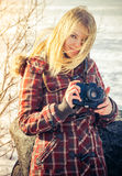 Young Woman with retro photo camera outdoor Royalty Free Stock Photo