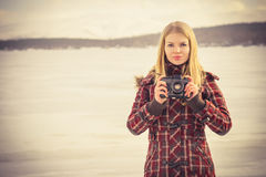 Young Woman with retro photo camera outdoor Stock Image