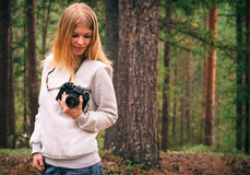 Young Woman with retro photo camera outdoor Travel Lifestyle Royalty Free Stock Photography