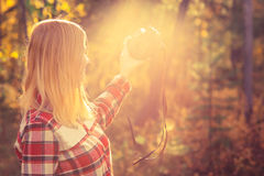 Young Woman with retro photo camera taking selfie shot. Outdoor hipster Lifestyle forest nature on background Royalty Free Stock Image
