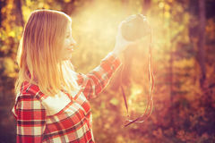 Young Woman with retro photo camera taking selfie Royalty Free Stock Photography