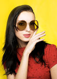 Young woman in  retro style. Portrait of young woman in sunglasses in retro style Royalty Free Stock Image