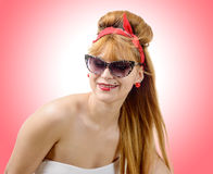 Young woman in retro style with sunglasses Stock Image