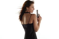 Young woman with revolver Royalty Free Stock Photo