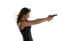 Young woman with revolver Royalty Free Stock Images