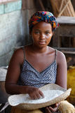 Young woman at the rice market Stock Photo