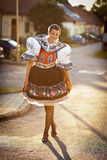 Young woman in a richly decorated ceremonial folk dress Royalty Free Stock Image