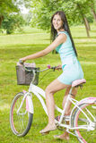 Young woman ride bicycle Stock Images
