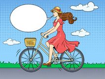 Young woman ride on bicycle pop art vector. Young beauty woman ride bicycle pop art retro vector illustration. Text bubble. Color background. Comic book style Royalty Free Stock Images