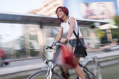 Young woman with ride bike in the city Stock Images