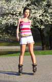 Young woman ride rollerblades Stock Photo