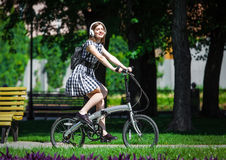 Young woman rides bicycle in the park Stock Photography