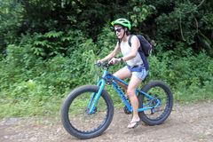 Young woman rides push up mountain bikes in Rarotonga Cook Islands stock images