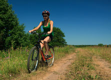 Young Woman Riding Bicycle Royalty Free Stock Image
