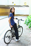 Young woman riding bicycle Stock Photo
