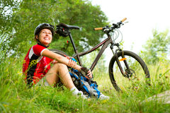 Young Woman riding bicycle. Happy Young Woman riding bicycle outside. Healthy Lifestyle Stock Photo