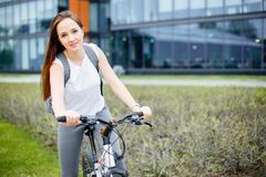 Young woman riding a bicycle in the city. The concept of an active way of life, sport and leisure.  Stock Images