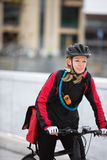 Young Woman Riding Bicycle With Courier Delivery Royalty Free Stock Photography