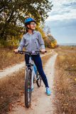 Young woman riding a bicycle in the field Royalty Free Stock Photography
