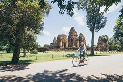 Free Young Woman Riding Bicycle Next To Pre Rup Temple In Angkor Wat Complex, Cambodia Royalty Free Stock Images - 155806139