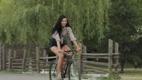 Young woman riding a bicycle outdoor stock footage