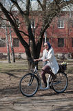 Young woman riding a bicycle Stock Photography