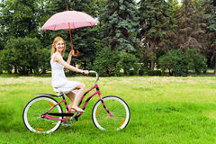 Young woman riding a bicycle Royalty Free Stock Photo