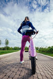 Young woman riding on bicycle in park Royalty Free Stock Images