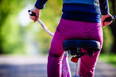 Young woman riding on bicycle in park Royalty Free Stock Image